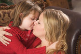 Mother and Daughter Share a Kiss — Stock Photo