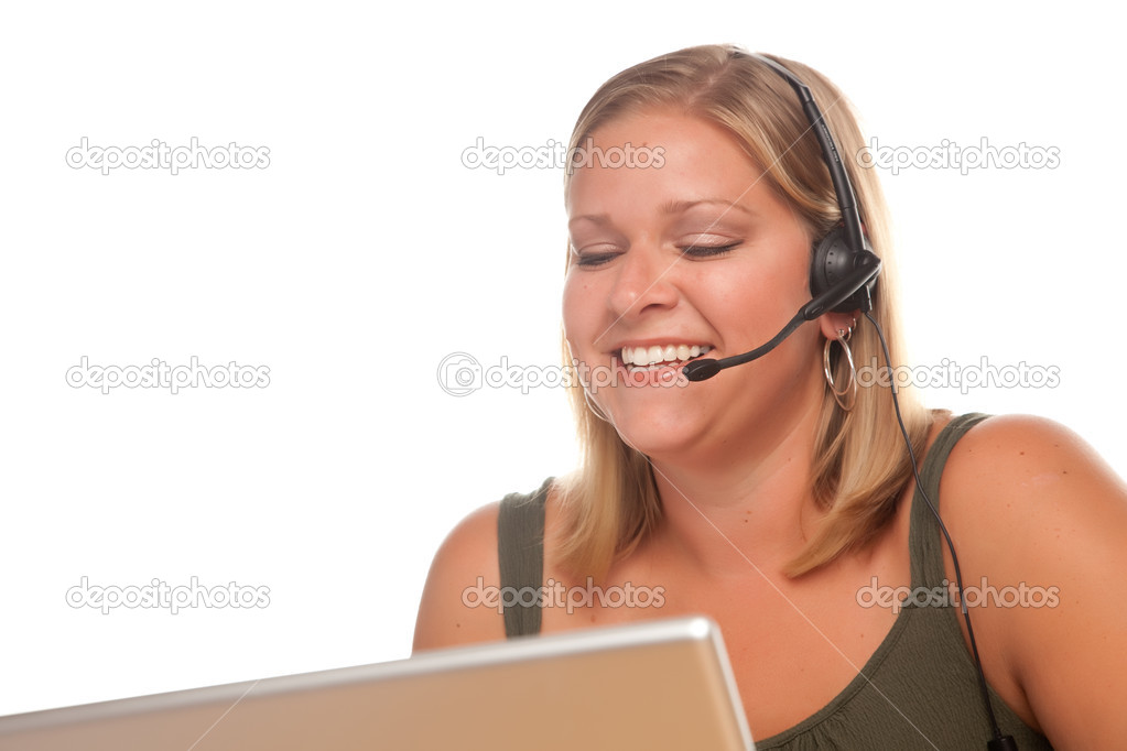Attractive businesswoman smiles as she talks on her phone headset. — Stock Photo #2342947