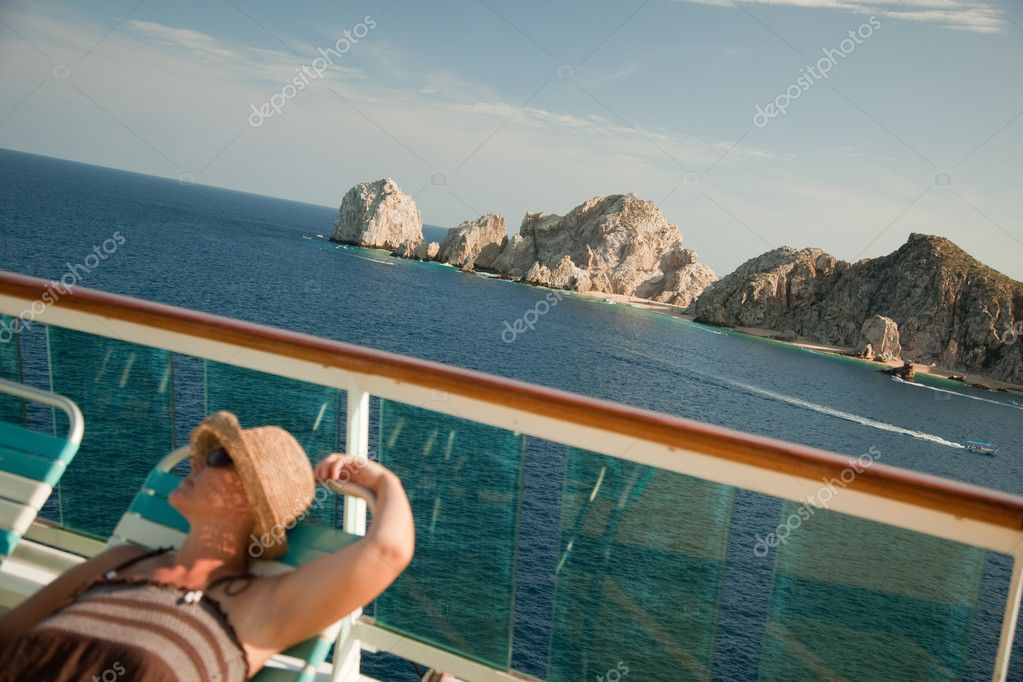 Beautiful Woman Relaxes on a Cruise Ship Deck at Land's End in Cabo San Lucas, Mexico. — Stock Photo #2345016