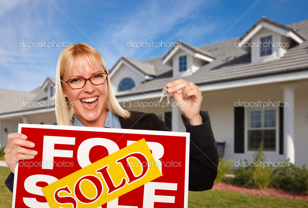 Beautiful Female Holding Keys to a New House & Sold Real Estate Sign. — Stock Photo #2345127
