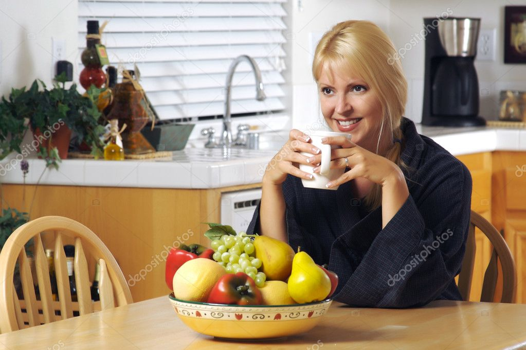 Beautiful young successful woman, enjoying a cup of coffee in her home. — Stock Photo #2345651