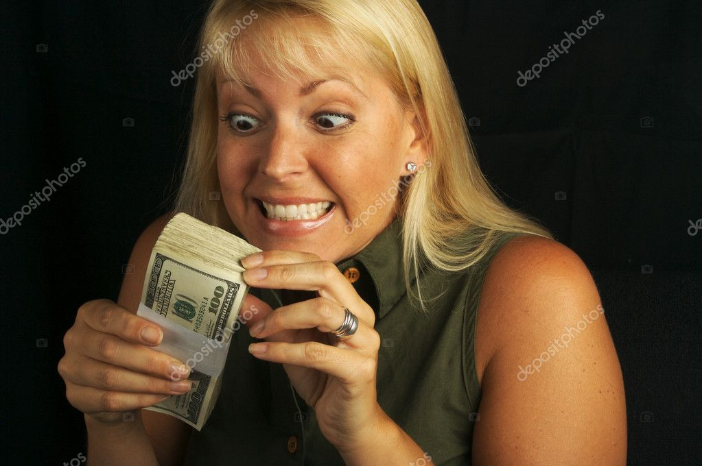 Attractive Woman Excited About her Stack of Money She Holds  Stock Photo #2345842