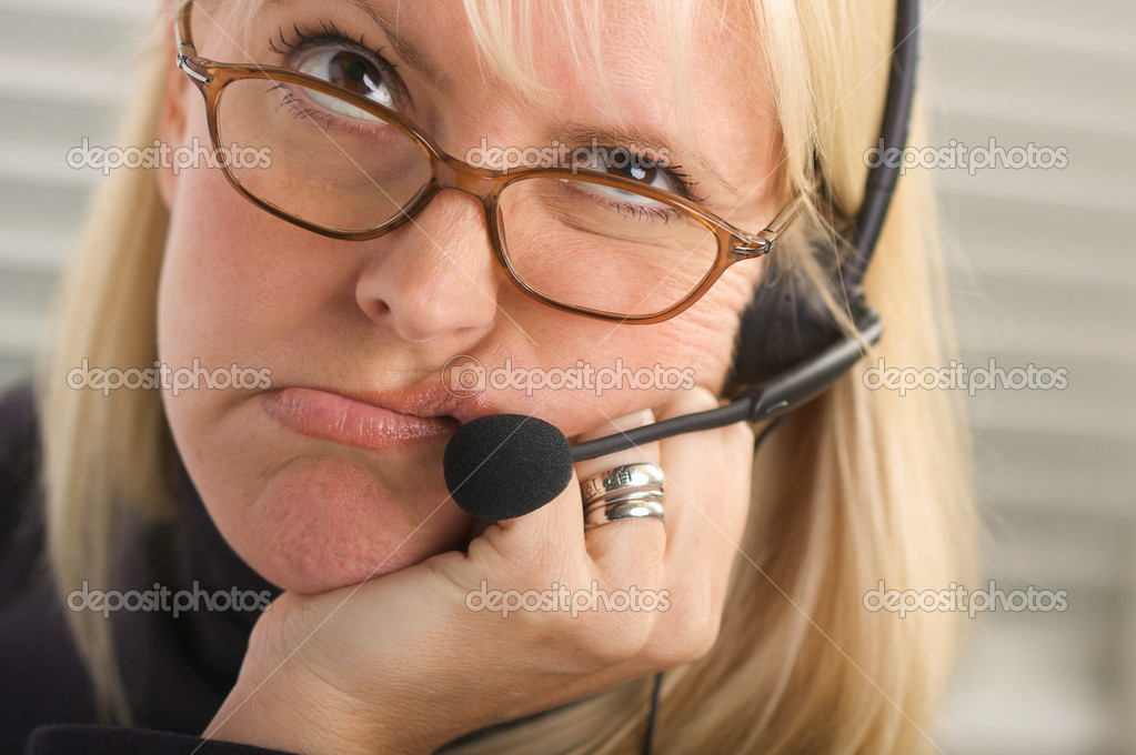 Bored businesswoman talks on her phone headset. — Stock Photo #2346821