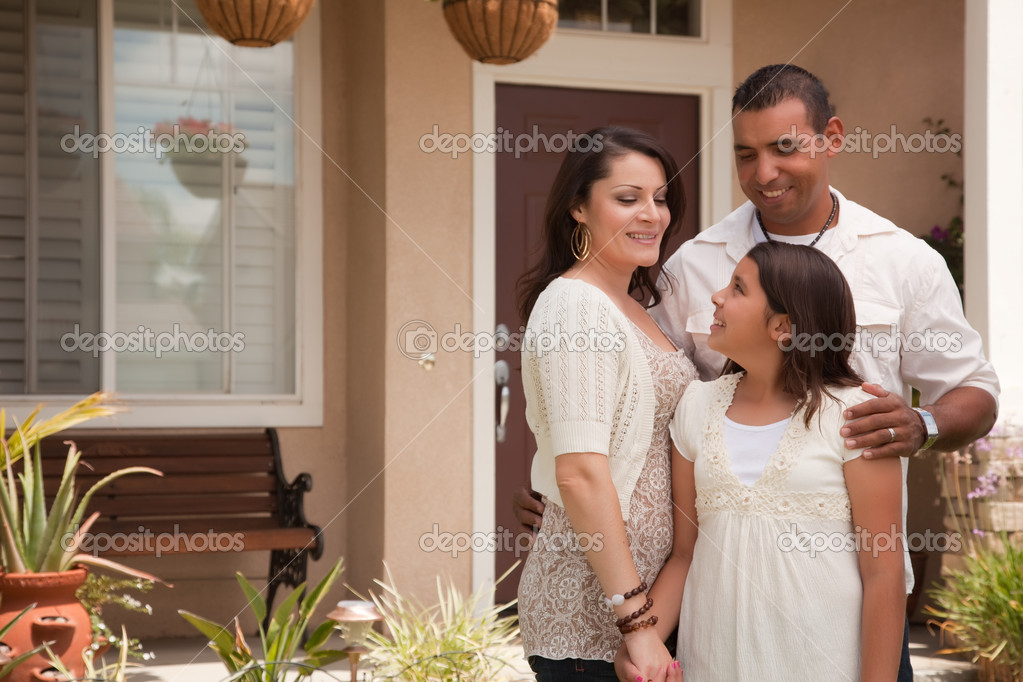 Small Hispanic Family in Front of Their Home — Stock Photo #2347603