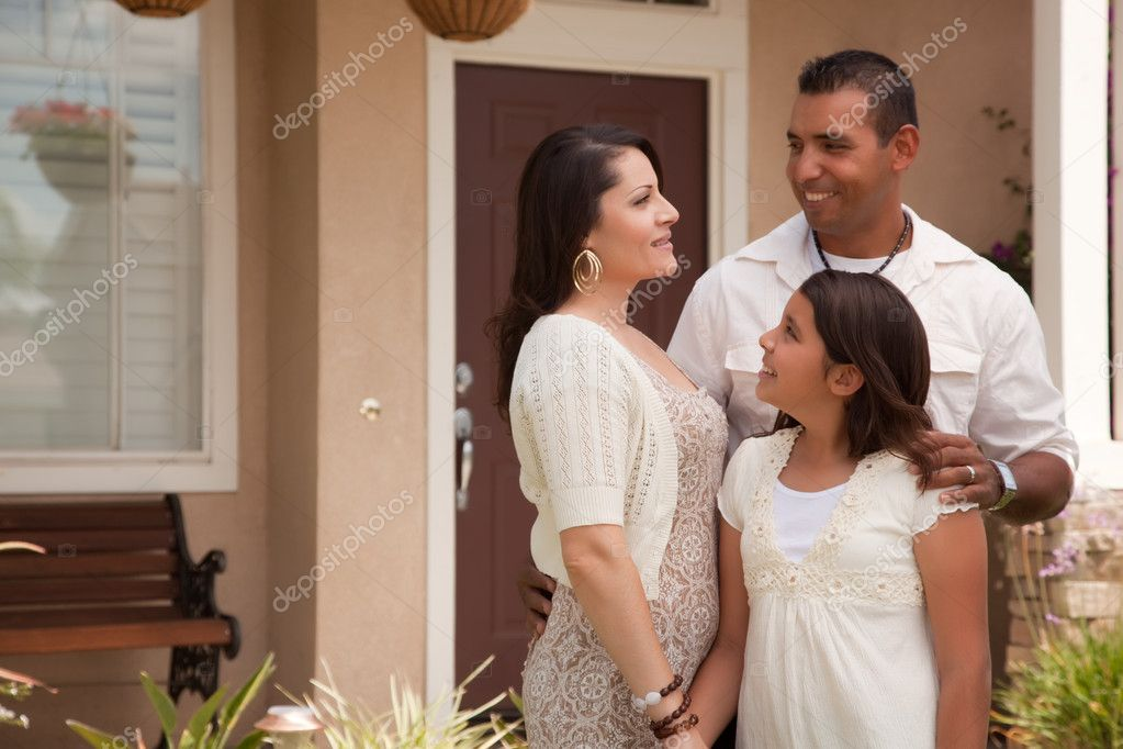 Small Hispanic Family in Front of Their Home — Stock Photo #2347631