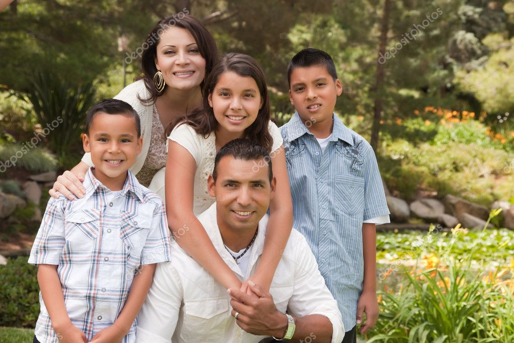 Happy Hispanic Family Portrait In the Park. — Foto Stock #2347639