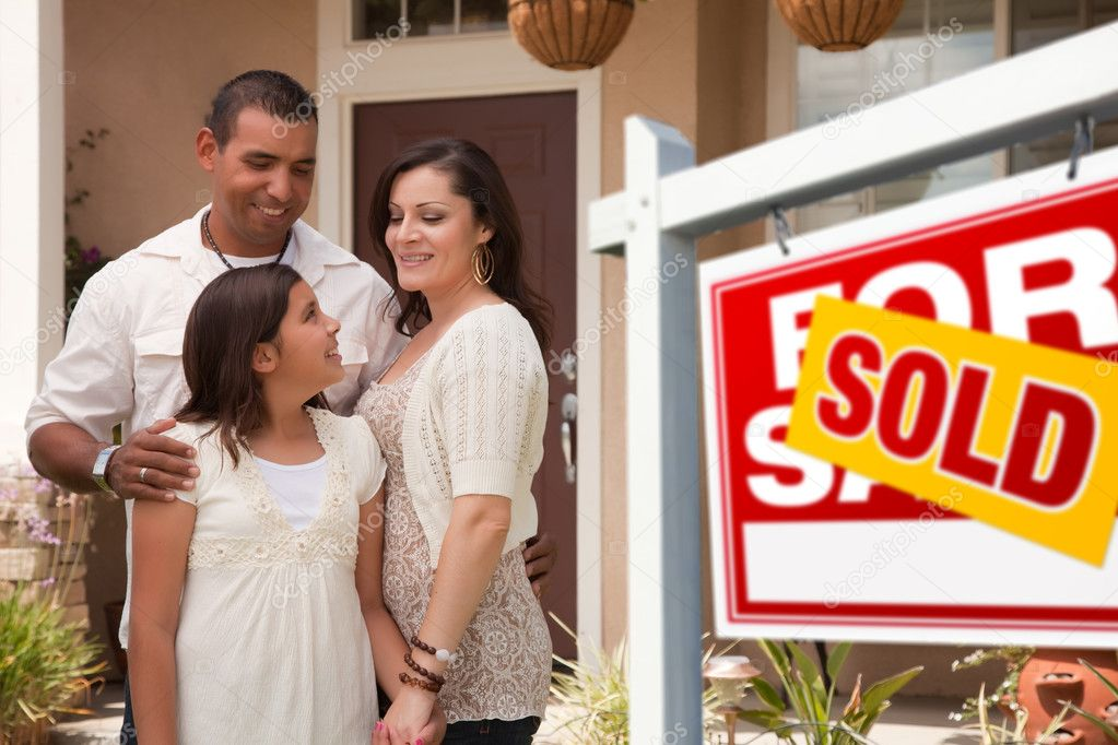 Hispanic Mother, Father and Daughter in Front of Their New Home with Sold Home For Sale Real Estate Sign.  Stock Photo #2347660