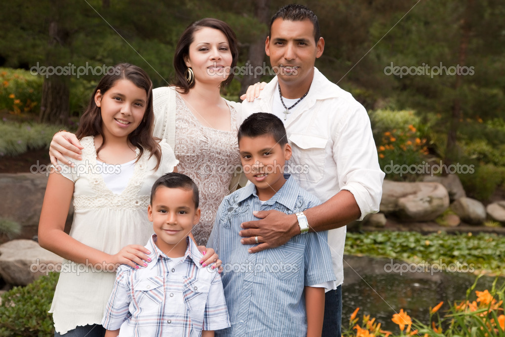 Happy Hispanic Family Portrait In the Park. — Stock Photo #2347702