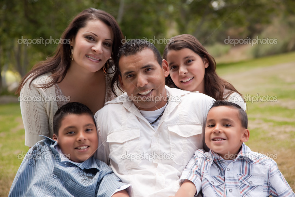 Happy Hispanic Family Portrait In the Park.  Stock Photo #2348158