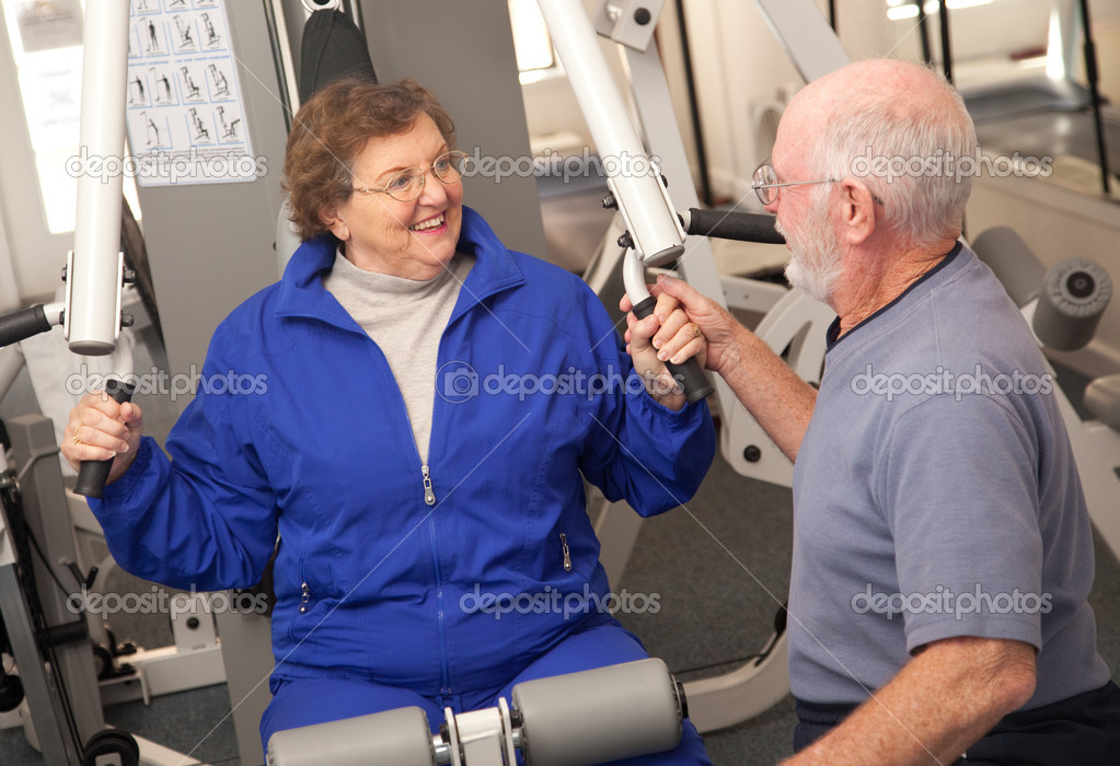 Senior Adult Couple Working Out in the Gym.  Stock Photo #2348613