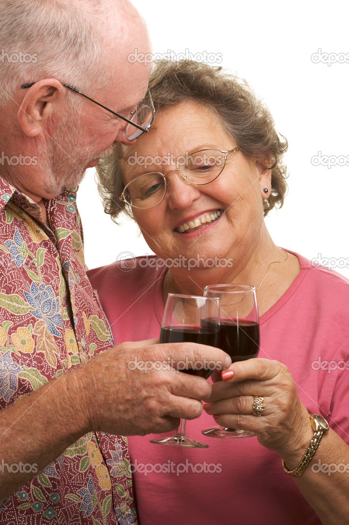 Happy Senior Couple toasting with wine glasses. — Stock Photo #2349490