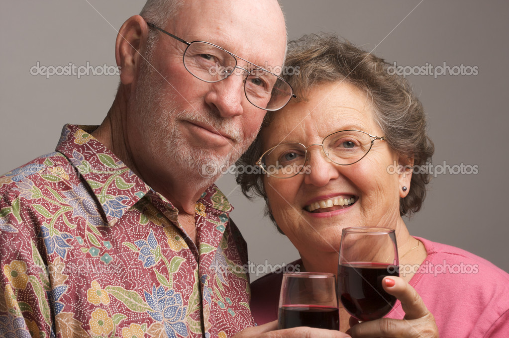 Happy Senior Couple toasting with wine glasses. — Stock Photo #2349628