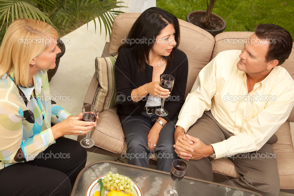 Three Friends Enjoying Wine on an Outdoor Patio. — Stock Photo #2349904