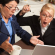 Royalty-Free Stock Photo: Two Women Using Laptop Celebrate Success