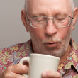 Senior Man Enjoys a Cup of Coffee — Stock Photo #2350653