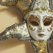 Beautiful Venetian Mask on Light Yellow Wall - Stock Photo