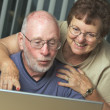 Stock Photo: Senior Adults on Working on a Laptop Computer