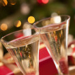 Sparkling Champagne Flutes and Lights — Stock Photo