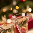 Sparkling Champagne Flutes and Lights - Stock Photo