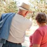 Loving Senior Couple Exploring Nature — Stock Photo #2352487