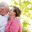 Loving Senior Couple Kissing and Enjoy Outdoors — Stock Photo
