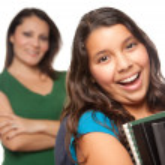 Hispanic Mother and Schoolgirl Daughter — Stock Photo #2352831