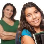 Hispanic Mother and Schoolgirl Daughter — Stock Photo #2352850
