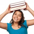 Pretty Hispanic Girl with Books on Head — Stock Photo