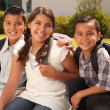 Cute Brothers and Sister in Backpacks — Stock Photo #2353009