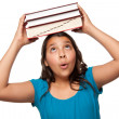 Pretty Hispanic Girl with Books on Head — Stock Photo #2353067