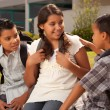 Young Brothers and Sister at School — Stock Photo