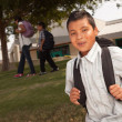 Stock Photo: Young Hispanic Boy On His Way to School
