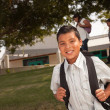 Foto Stock: Young Hispanic Boy On His Way to School