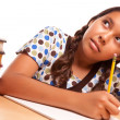 Stock Photo: Hispanic Girl Studying & Daydreaming