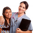 Young Hispanic Girl and Female Doctor - Stock Photo