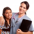 Royalty-Free Stock Photo: Young Hispanic Girl and Female Doctor