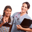 Royalty-Free Stock Photo: Pretty Hispanic Girl and Female Doctor