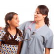 Pretty Hispanic Girl and Female Doctor — ストック写真