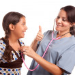 Pretty Hispanic Girl and Female Doctor — Stockfoto