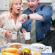 Stressed Couple Eating, Looking at Time — Stockfoto