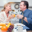 Businessman and Wife with Juice — Stock Photo #2354337