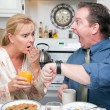 Stressed Couple Eating, Looking at Time — Stock Photo #2354379