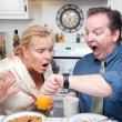 Stressed Couple Eating, Looking at Time — Stock Photo