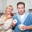 Couple in Kitchen with Fruit and Donuts — Stock Photo #2354483