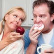 Couple in Kitchen with Fruit and Donuts — Stock Photo #2354503