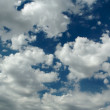 Tranquil Clouds and Deep Blue Sky - Stock Photo