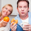 Couple in Kitchen with Fruit and Donuts — Stock Photo