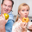 Couple in Kitchen with Fruit and Donuts — Stock Photo #2354781