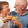 Happy Senior Couple with Orange Juice — Stock Photo
