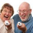 Fun Senior Couple with Game Controllers — Stock Photo